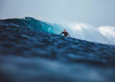 woman surfing Maldives